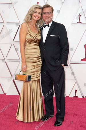 Aaron Sorkin (L) and Paulina Porizkova arrive on the red carpet of The 93rd Oscars® at Union Station in Los Angeles, CA on Sunday, April 25, 2021