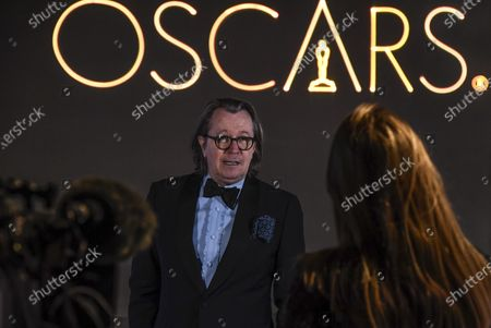 Gary Oldman is interviewed upon arrival at a screening of the Oscars on in London