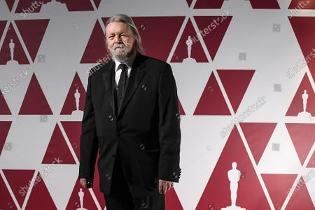 Stock Photo of Christopher Hampton arrives at a screening of the Oscars on in London
