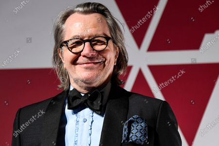 Stock Photo of Gary Oldman arrives at a screening of the Oscars