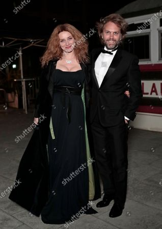 Florian Zeller, right, and Marine Delterme arrive to attend a screening of the Oscars on in Paris, France