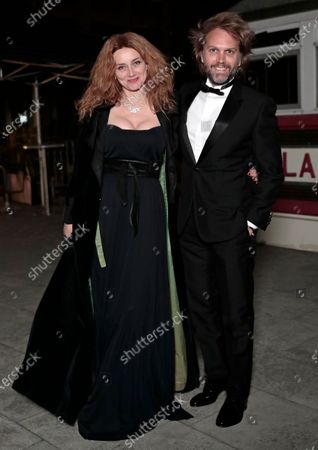 Florian Zeller, right, and Marine Delterme arrive to attend a screening of the Oscars