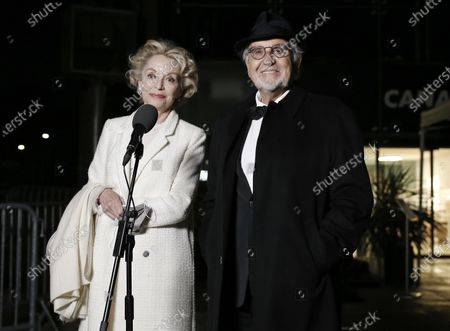 Jean-Louis Livi and Caroline Silhol arrive to attend a screening of the Oscars