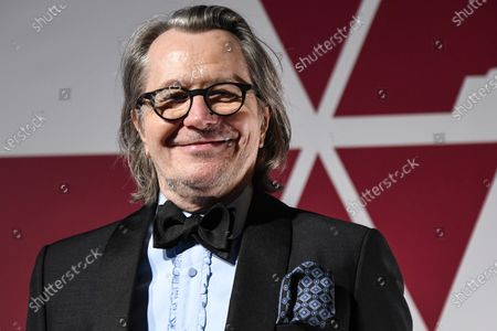 Gary Oldman arrives for the 93rd annual Academy Awards screening in London, Britain, 26 April 2021. The Oscars are presented for outstanding individual or collective efforts in filmmaking in 24 categories. The Oscars happen two months later than originally planned, due to the impact of the coronavirus COVID-19 pandemic on cinema.
