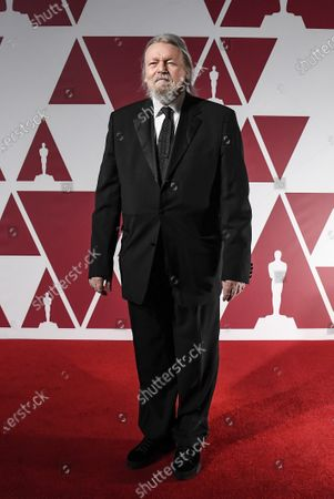 Christopher Hampton arrives for the 93rd annual Academy Awards screening in London, Britain, 26 April 2021. The Oscars are presented for outstanding individual or collective efforts in filmmaking in 24 categories. The Oscars happen two months later than originally planned, due to the impact of the coronavirus COVID-19 pandemic on cinema.