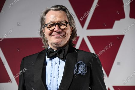 Stock Image of Gary Oldman arrives for the 93rd annual Academy Awards screening in London, Britain, 26 April 2021. The Oscars are presented for outstanding individual or collective efforts in filmmaking in 24 categories. The Oscars happen two months later than originally planned, due to the impact of the coronavirus COVID-19 pandemic on cinema.