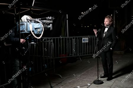 Florian Zeller gestures as he speaks upon his arrival to attend a screening for the 93rd annual Academy Awards in Paris, France 26 April 2021. The Oscars are presented for outstanding individual or collective efforts in filmmaking in 24 categories. The Oscars happen two months later than originally planned, due to the impact of the coronavirus COVID-19 pandemic on cinema.