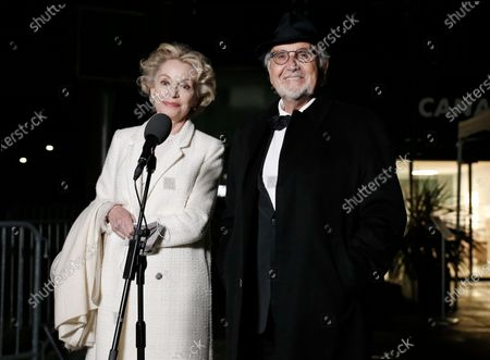 Jean-Louis Livi and Caroline Silhol arrive to attend a screening for the 93rd annual Academy Awards in Paris, France 26 April 2021. The Oscars are presented for outstanding individual or collective efforts in filmmaking in 24 categories. The Oscars happen two months later than originally planned, due to the impact of the coronavirus COVID-19 pandemic on cinema.