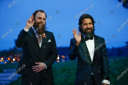 Fat Max Gsus (L) and Savan Kotecha attend the 93rd annual Academy Awards screening in Stockholm, Sweden, 26 April 2021. The Oscars are presented for outstanding individual or collective efforts in filmmaking in 24 categories. The Oscars happen two months later than originally planned, due to the impact of the coronavirus COVID-19 pandemic on cinema.
