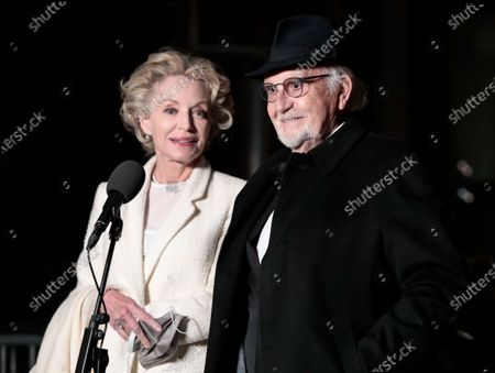 Jean-Louis Livi and Caroline Silhol arrive to attend a screening of the Oscars on in Paris, France
