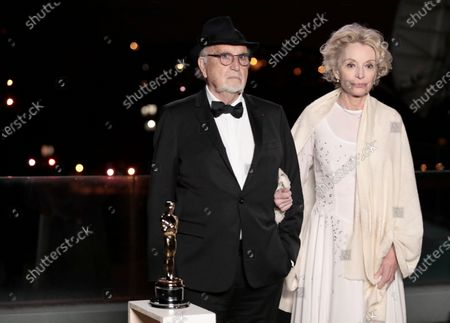 Jean-Louis Livi and Caroline Silhol pose for a photo during a screening of the Oscars on in Paris, France