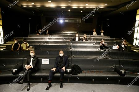 Nominees, including: Yorgos Lamprinos, bottom center, Adrien Merigeau, center left, Amaury Ovise, center second right, Nicolas Becker, center, Jean-Louis Livi, top right, and Florian Zeller, top second left, attend a screening of the Oscars on in Paris, France
