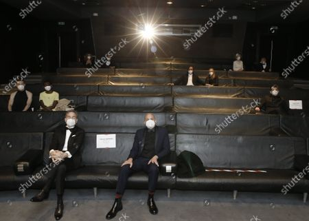 Nominees, including: Yorgos Lamprinos, bottom center, Adrien Merigeau, center left, Amaury Ovise, center right, Nicolas Becker, center, Jean-Louis Livi, top right, and Florian Zeller, top second left, attend a screening of the Oscars on in Paris, France