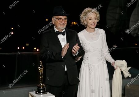 Stock Photo of Jean-Louis Livi and Caroline Silhol pose for a photo during a screening of the Oscars on in Paris, France