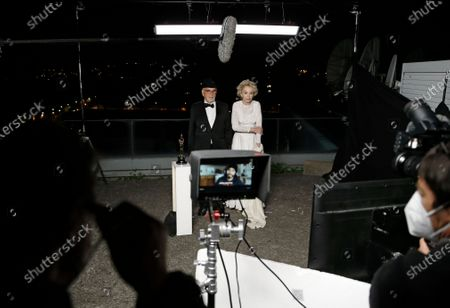 Stock Image of Jean-Louis Livi and Caroline Silhol pose for a photo during a screening of the Oscars on in Paris, France