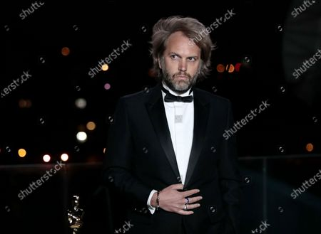 Florian Zeller after winning the Best Adapted Screenplay for the 'The Father' at a screening of the Oscars on in Paris, France