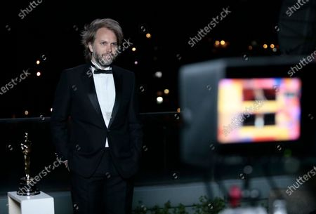 Florian Zeller is interviewed after winning the Best Adapted Screenplay for the 'The Father' at a screening of the Oscars on in Paris, France