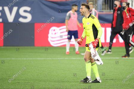 New England Revolution goalkeeper Matt Turner (30) reacts after an MLS soccer match win against DC United, in Foxborough, Mass