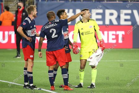 New England Revolution goalkeeper Matt Turner (30) reacts with teammates after an MLS soccer match win against DC United, in Foxborough, Mass