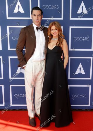 Sacha Baron Cohen and Isla Fisher arrive to attend a screening of the Oscars