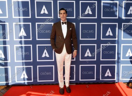 Sacha Baron Cohen arrives to attend a screening of the Oscars