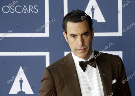 Sacha Baron Cohen poses for a photo during a screening of the Oscars