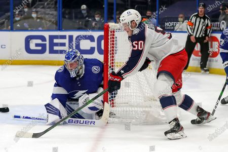 Stock Image of Columbus Blue Jackets' Eric Robinson (50) scores past Tampa Bay Lightning goaltender Andrei Vasilevskiy, of Russia, during the first period of an NHL hockey game, in Tampa, Fla