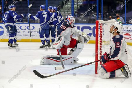 Columbus Blue Jackets goaltender Joonas Korpisalo (70), of Finland, and Michael Del Zotto react as Tampa Bay Lightning's Mathieu Joseph (7) celebrates his goal during the second period of an NHL hockey game, in Tampa, Fla