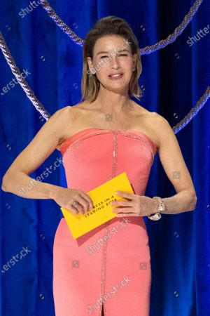 Stock Image of Renee Zellweger presents the Oscar® for Actress in a Leading Role to Frances McDormand during the live ABC Telecast of The 93rd Oscars® at Union Station in Los Angeles, CA on Sunday, April 25, 2021.