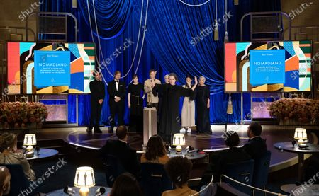 Peter Spears, Frances McDormand, Chloe Zhao, Mollye Asher, and Dan Janvey pose backstage with the Oscar® for Best Picture during the live ABC Telecast of The 93rd Oscars® at Union Station in Los Angeles, CA on Sunday, April 25, 2021.