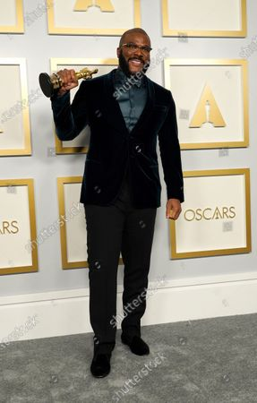 Tyler Perry, winner of the Jean Hersholt Humanitarian Award, poses in the press room at the Oscars, at Union Station in Los Angeles