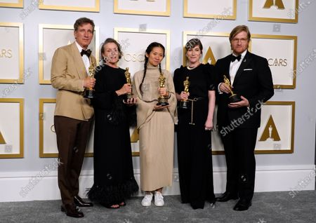 """Producers Peter Spears, from left, Frances McDormand, Chloe Zhao, Mollye Asher and Dan Janvey, winners of the award for best picture for """"Nomadland,"""" pose in the press room at the Oscars, at Union Station in Los Angeles"""