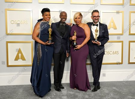 "Don Cheadle, second left, poses with the winners of the award for best makeup and hairstyling for ""Ma Rainey's Black Bottom,"" Mia Neal, from left, Jamika Wilson and Sergio Lopez-Rivera in the press room at the Oscars, at Union Station in Los Angeles"
