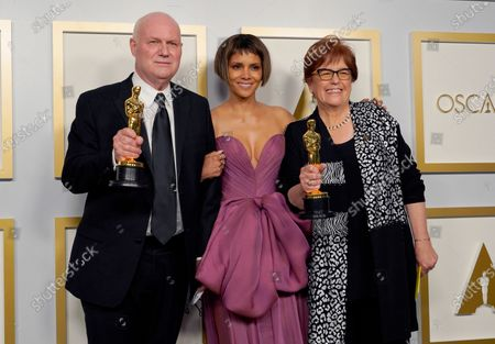 """Donald Graham Burt, from left, winner of the award for best production design for """"Mank"""", presenter Halle Berry and Jan Pascale, right, winner of the award for best production design for """"Mank"""" pose in the press room at the Oscars, at Union Station in Los Angeles"""