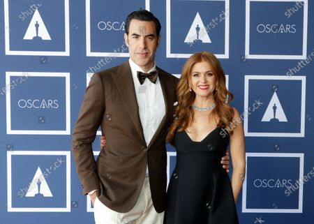 Sacha Baron Cohen and Isla Fisher pose for a photo during a screening of the Oscars on in Sydney, Australia