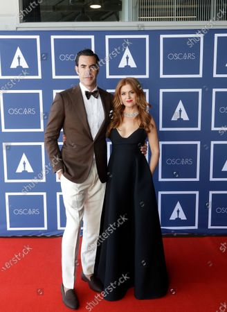 Stock Picture of Sacha Baron Cohen and Isla Fisher pose for a photo during a screening of the Oscars on in Sydney, Australia
