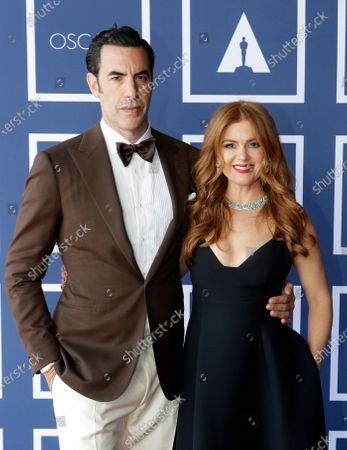 Sacha Baron Cohen and Isla Fisher attend the 93rd annual Academy Awards screening in Sydney, Australia, 26 April 2021. The Oscars are presented for outstanding individual or collective efforts in filmmaking in 24 categories. The Oscars happen two months later than originally planned, due to the impact of the coronavirus COVID-19 pandemic on cinema.