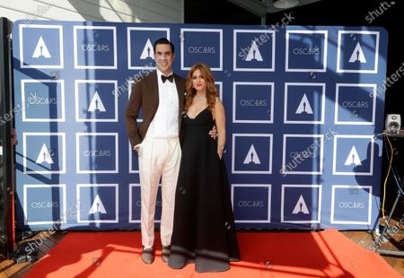 Sacha Baron Cohen and Isla Fisher arrive for the 93rd annual Academy Awards screening in Sydney, Australia, 26 April 2021. The Oscars are presented for outstanding individual or collective efforts in filmmaking in 24 categories. The Oscars happen two months later than originally planned, due to the impact of the coronavirus COVID-19 pandemic on cinema.