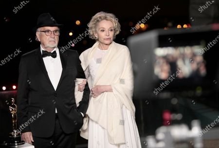 Jean-Louis Livi and Caroline Silhol attend the screening for the 93rd annual Academy Awards in Paris, France 26 April 2021. The Oscars are presented for outstanding individual or collective efforts in filmmaking in 24 categories. The Oscars happen two months later than originally planned, due to the impact of the coronavirus COVID-19 pandemic on cinema.