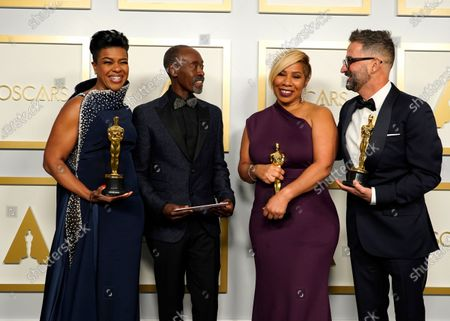 Stock Photo of Don Cheadle (2-L) poses with the winners of the award for best makeup and hairstyling for 'Ma Rainey's Black Bottom,'  Mia Neal, Jamika Wilson and Sergio Lopez-Rivera in the press room at the 93rd annual Academy Awards ceremony at Union Station in Los Angeles, California, USA, 25 April 2021. The Oscars are presented for outstanding individual or collective efforts in filmmaking in 24 categories. The Oscars happen two months later than originally planned, due to the impact of the coronavirus COVID-19 pandemic on cinema.