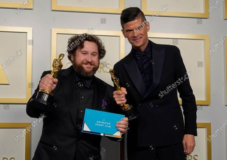 Michael Govier (L) and Will McCormack pose in the press room with the award for best animated short film for 'If Anything Happens I Love You' at the 93rd annual Academy Awards ceremony at Union Station in Los Angeles, California, USA, 25 April 2021. The Oscars are presented for outstanding individual or collective efforts in filmmaking in 24 categories. The Oscars happen two months later than originally planned, due to the impact of the coronavirus COVID-19 pandemic on cinema.