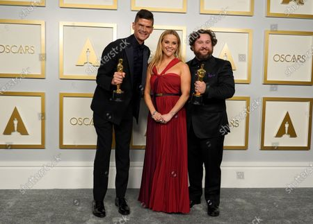 Reese Witherspoon (C) poses with Will McCormack (L) and Michael Govier (R), winners of the award for the best animated short film for 'If Anything Happens I Love You,' in the press room at the 93rd annual Academy Awards ceremony at Union Station in Los Angeles, California, USA, 25 April 2021. The Oscars are presented for outstanding individual or collective efforts in filmmaking in 24 categories. The Oscars happen two months later than originally planned, due to the impact of the coronavirus COVID-19 pandemic on cinema.