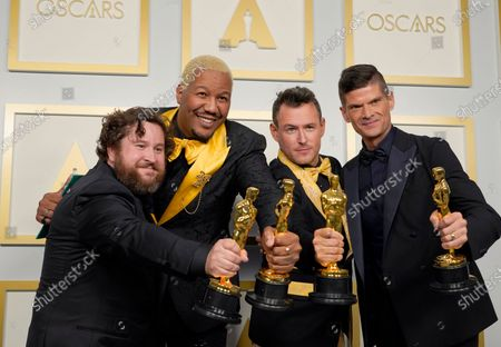 Michael Govier (L) and Will McCormack (R), winners of the award for best animated short film for 'If Anything Happens I Love You,' pose with Travon Free (2-L) and Martin Desmond Roe (2-R), winners of the award for best live action short film for 'Two Distant Strangers,' in the press room at the 93rd annual Academy Awards ceremony at Union Station in Los Angeles, California, USA, 25 April 2021. The Oscars are presented for outstanding individual or collective efforts in filmmaking in 24 categories. The Oscars happen two months later than originally planned, due to the impact of the coronavirus COVID-19 pandemic on cinema.