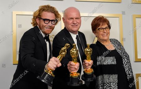 Stock Image of Erik Messerschmidt (L), winner of the award for best cinematography for 'Mank,' poses with Donald Graham Burt (C) and Jan Pascale (R), winners of the award for best production design for 'Mank,' in the press room at the 93rd annual Academy Awards ceremony at Union Station in Los Angeles, California, USA, 25 April 2021. The Oscars are presented for outstanding individual or collective efforts in filmmaking in 24 categories. The Oscars happen two months later than originally planned, due to the impact of the coronavirus COVID-19 pandemic on cinema.