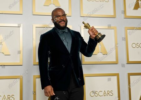 Stock Picture of Tyler Perry, winner of the Jean Hersholt Humanitarian Award, poses in the press room at the 93rd annual Academy Awards ceremony at Union Station in Los Angeles, California, USA, 25 April 2021. The Oscars are presented for outstanding individual or collective efforts in filmmaking in 24 categories. The Oscars happen two months later than originally planned, due to the impact of the coronavirus COVID-19 pandemic on cinema.