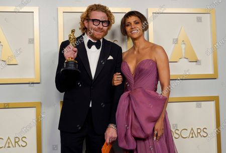Erik Messerschmidt (L), winner of the award for best cinematography for 'Mank' poses with Halle Berry (R) in the press room at the 93rd annual Academy Awards ceremony at Union Station in Los Angeles, California, USA, 25 April 2021. The Oscars are presented for outstanding individual or collective efforts in filmmaking in 24 categories. The Oscars happen two months later than originally planned, due to the impact of the coronavirus COVID-19 pandemic on cinema.