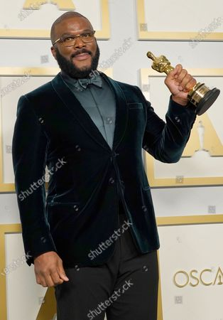 Stock Image of Tyler Perry, winner of the Jean Hersholt Humanitarian Award, poses in the press room at the 93rd annual Academy Awards ceremony at Union Station in Los Angeles, California, USA, 25 April 2021. The Oscars are presented for outstanding individual or collective efforts in filmmaking in 24 categories. The Oscars happen two months later than originally planned, due to the impact of the coronavirus COVID-19 pandemic on cinema.