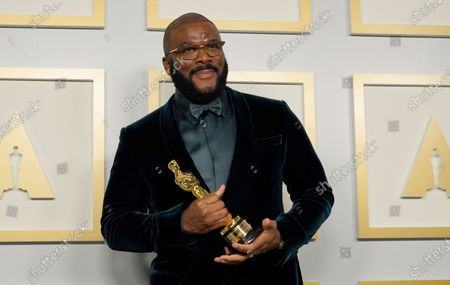 Stock Photo of Tyler Perry, winner of the Jean Hersholt Humanitarian Award, poses in the press room at the 93rd annual Academy Awards ceremony at Union Station in Los Angeles, California, USA, 25 April 2021. The Oscars are presented for outstanding individual or collective efforts in filmmaking in 24 categories. The Oscars happen two months later than originally planned, due to the impact of the coronavirus COVID-19 pandemic on cinema.