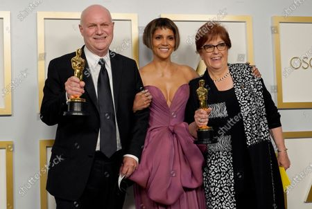 Halle Berry (C) poses with Donald Graham Burt (L) and Jan Pascale (R), winners of the award for best production design for 'Mank,' in the press room at the 93rd annual Academy Awards ceremony at Union Station in Los Angeles, California, USA, 25 April 2021. The Oscars are presented for outstanding individual or collective efforts in filmmaking in 24 categories. The Oscars happen two months later than originally planned, due to the impact of the coronavirus COVID-19 pandemic on cinema.
