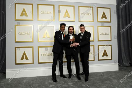 Jon Batiste, Trent Reznor and Atticus Ross, winners of the award for best original score for 'Soul,' pose in the press room at the 93rd annual Academy Awards ceremony at Union Station in Los Angeles, California, USA, 25 April 2021. The Oscars are presented for outstanding individual or collective efforts in filmmaking in 24 categories. The Oscars happen two months later than originally planned, due to the impact of the coronavirus COVID-19 pandemic on cinema.